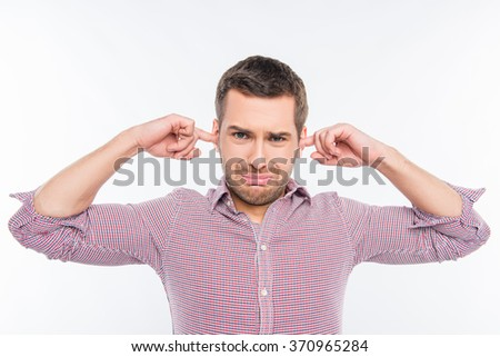 Handsome man closed his ears - stock photo