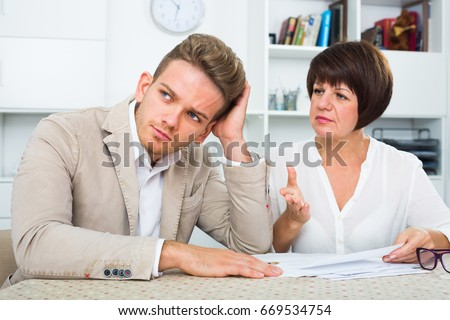 Handsome man consults at the familiar lawyer concerning paperwork