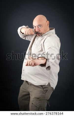 Handsome man doing different expressions in different sets of clothes: boxer - stock photo
