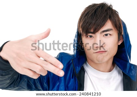 handsome man doing different expressions in different sets of clothes: gun sign - stock photo