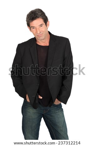 Handsome man doing different expressions in different sets of clothes: hands in pockets - stock photo