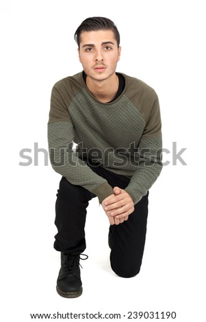 Handsome man doing different expressions in different sets of clothes: kneel - stock photo