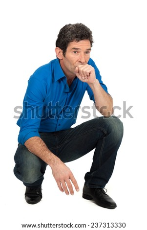 Handsome man doing different expressions in different sets of clothes: kneeling - stock photo