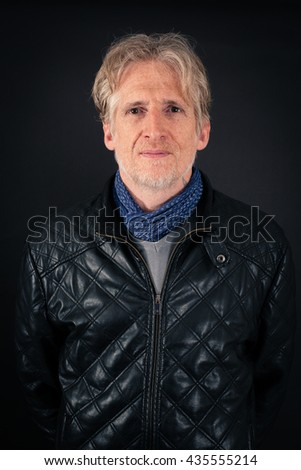 Handsome man doing different expressions in different sets of clothes: love - stock photo