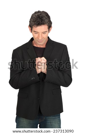 Handsome man doing different expressions in different sets of clothes: prayer - stock photo