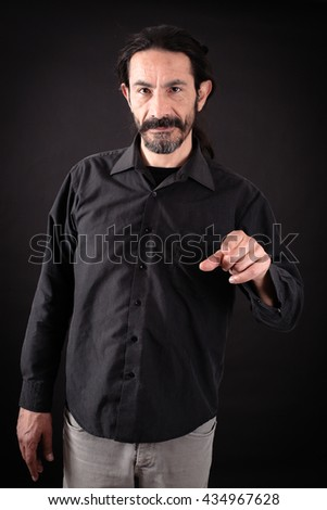Handsome man doing different expressions in different sets of clothes: showing - stock photo