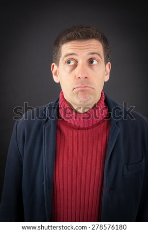 Handsome man doing different expressions in different sets of clothes: thinking - stock photo