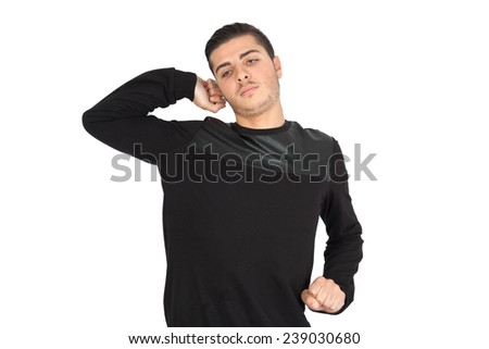 Handsome man doing different expressions in different sets of clothes: waking up - stock photo