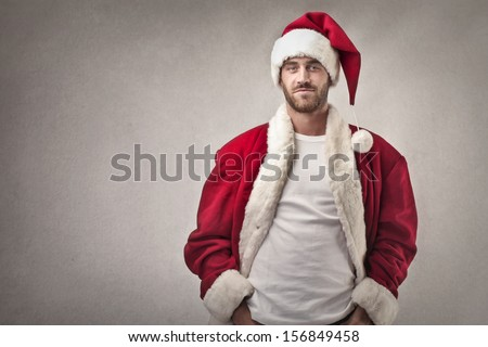 handsome man dressed as Santa Claus - stock photo