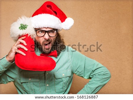 handsome man dressed as Santa Claus
