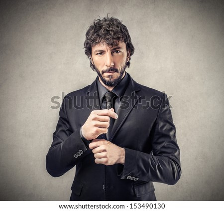 handsome man dressed in elegant suit - stock photo