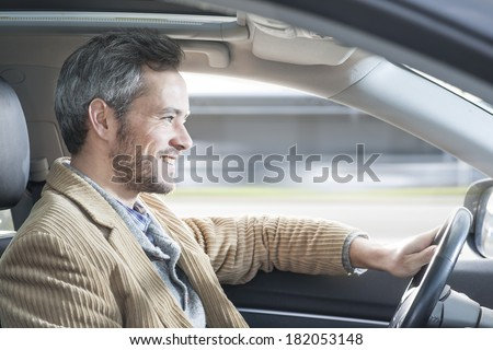 handsome man driving a car - stock photo