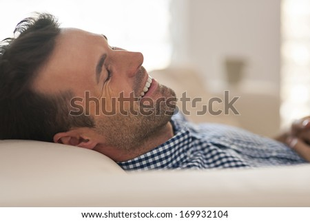 Handsome man during the afternoon nap - stock photo