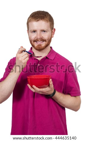 Handsome man eating food from a bowl