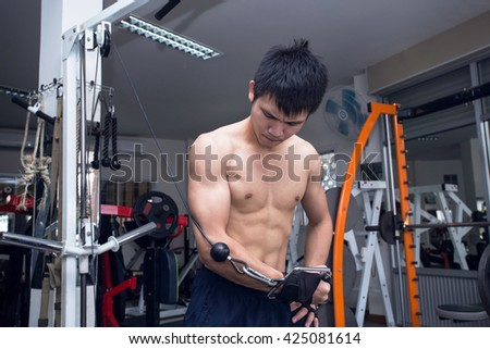 handsome man exercising at the gym - stock photo