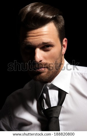 Handsome man face with white shirt and tie - stock photo