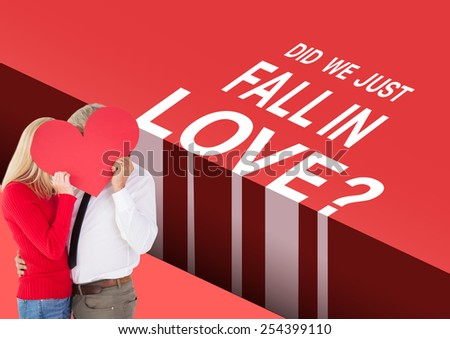Handsome man getting a heart card form wife against valentines day greeting - stock photo