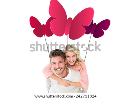 Handsome man giving piggy back to his girlfriend against butterfly - stock photo