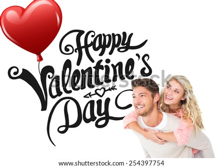 Handsome man giving piggy back to his girlfriend against cute valentines message - stock photo