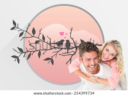 Handsome man giving piggy back to his girlfriend against love birds - stock photo