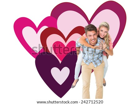 Handsome man giving piggy back to his girlfriend against valentines love hearts - stock photo