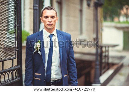 handsome man groom outdoors