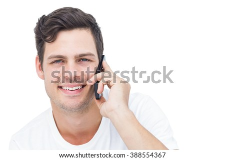 Handsome man having a phone call on white background