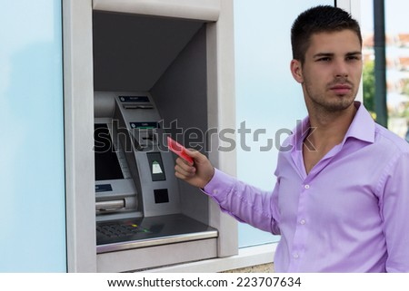 Handsome man holding a credit card
