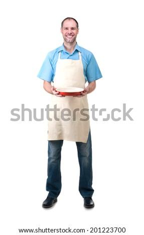 Handsome man holding a dish for your - stock photo