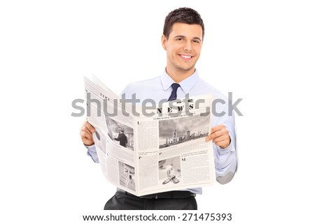Handsome man holding a newspaper and leaning against a wall. The newspaper is custom made, the text is Latin and the pictures are my copyright.