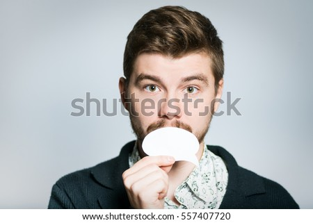 Handsome man holding a sticker, isolated on background