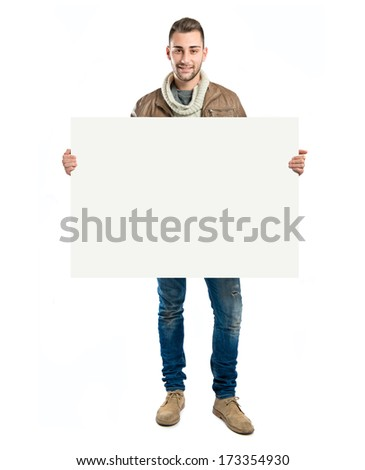 handsome man holding an empty cardboard over white background - stock photo