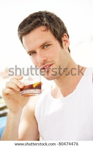 Handsome man holding glass