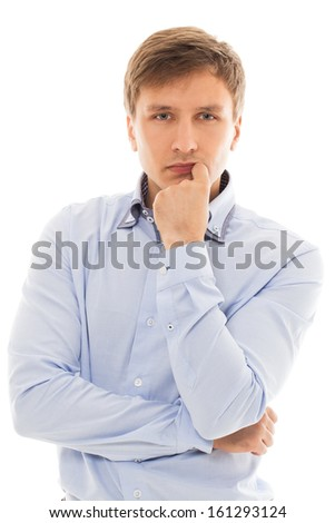 Handsome man in a blue shirt is thinking over a white background