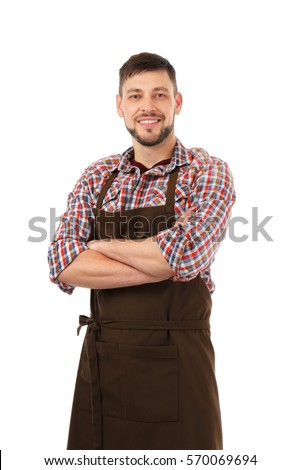 Handsome man in apron isolated on white background