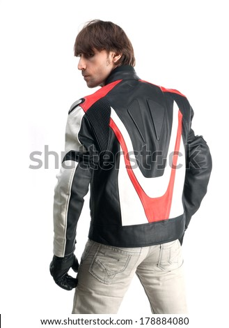 Handsome man in biker jacket and gloves isolated on white background