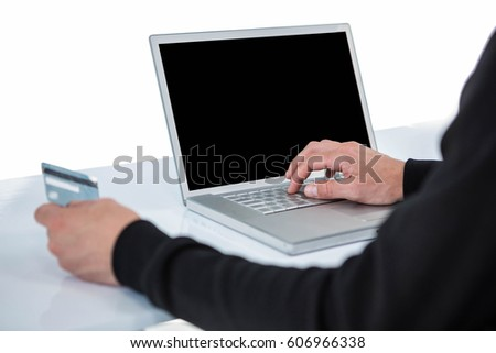 Handsome man in black hoodie doing online shopping on white background