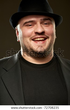 Handsome man in black suite with hat
