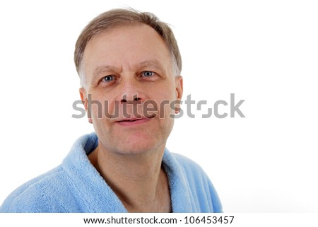 Handsome man in blue bathrobe looking at you.