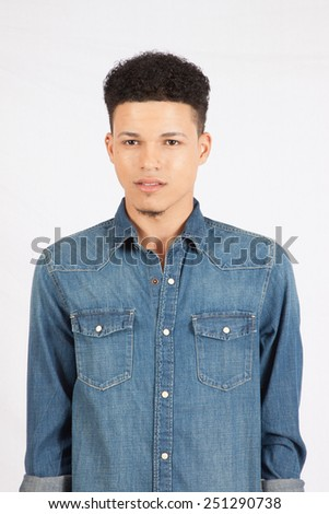 Handsome man in blue jean shirt with a thoughtful attitude - stock photo