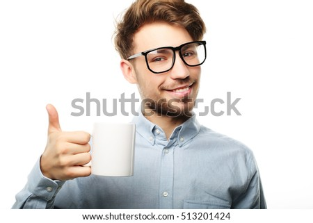 Handsome   man in casual clothes  holding a cup