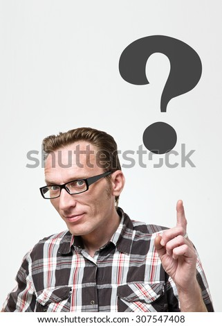 Handsome man in eyeglasses and tartan shirt  put his index finger up and show for question mark. Question concept - stock photo