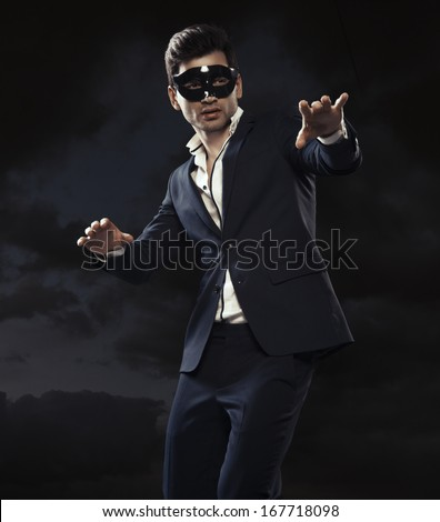 Handsome man in mask - stock photo