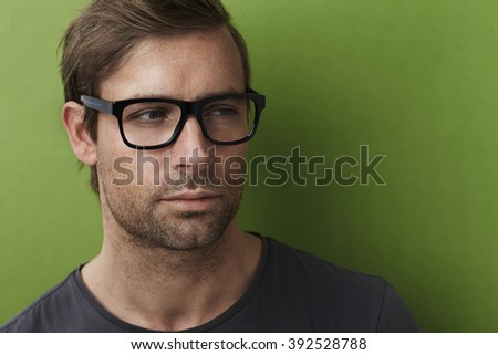 Handsome man in spectacles, looking away