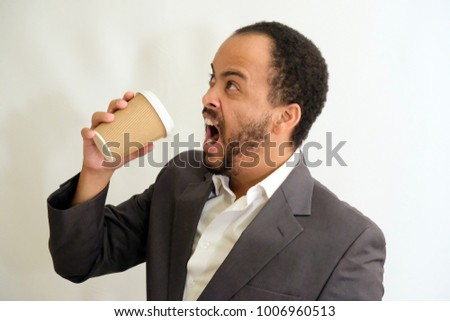 Handsome Man in Suit about to drink coffee
