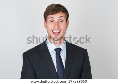 handsome man in suit excited - stock photo