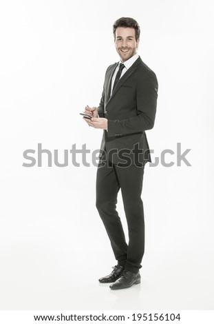 handsome man in suit texting on a phone on isolated background - stock photo