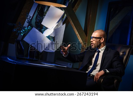 Handsome man in suit throwing documents
