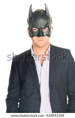 handsome man in suit wearing a batman mask isolated - stock photo