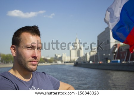 Handsome man in the boat on Moscow river - stock photo